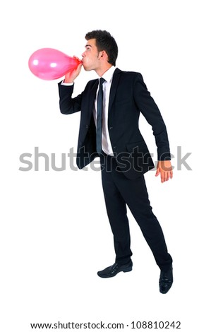 Isolated young business man with balloon