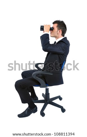 Isolated young business man with binocular