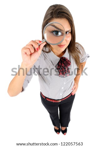 Isolated young business woman magnifying