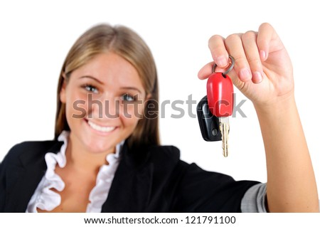 Isolated young business woman showing car key