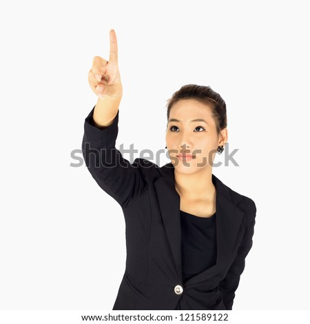 Isolated Young  Business woman touches a screen on white