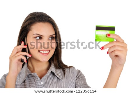 Isolated young business woman with credit card - stock photo