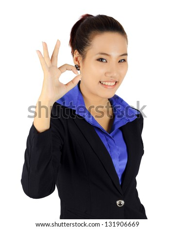Isolated young business woman with okay signal on white