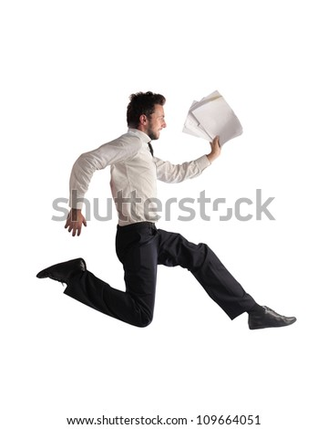 Isolated young businessman running with some documents in his hand