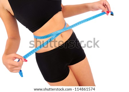 Isolated young fitness woman measuring