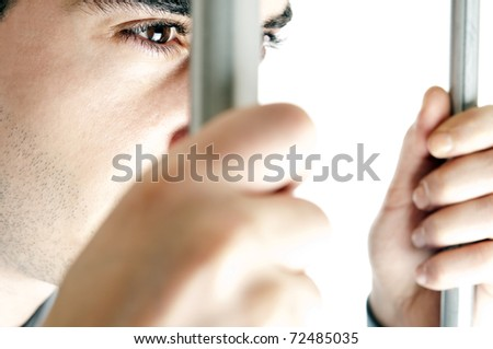 Isolated young man in jail
