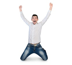 Isolated young man winner hands up