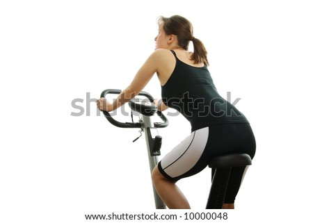 Isolated young woman riding on a bicycle from back