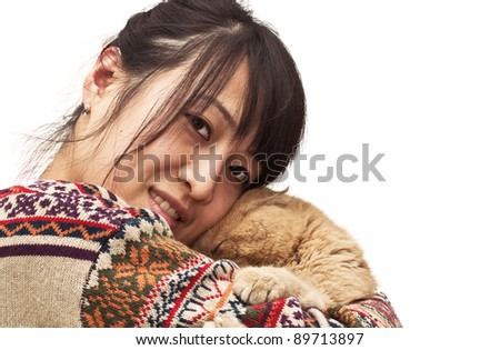 Isolation photo of a pretty Chinese girl hugging her pet, a CPA garfield cat