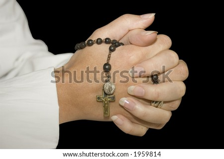 isoled folded hands with rosary. (clipping path included)