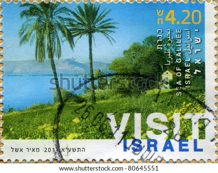 ISRAEL-CIRCA 2011: A stamp printed in ISRAEL shows The Sea of Galilee, Palm Trees , circa 2011