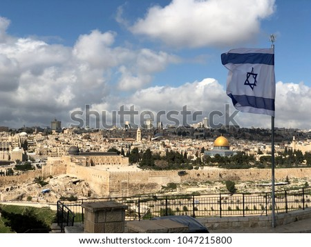 Israel flag above the old city of Jerusalem Israel