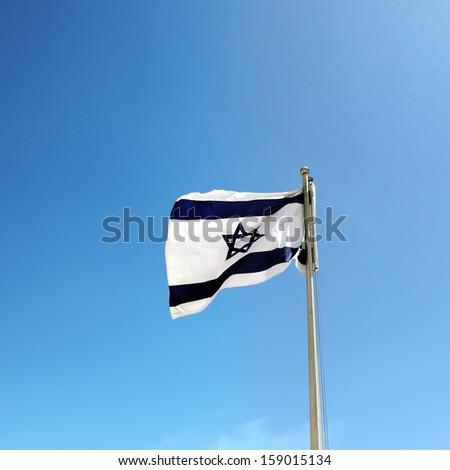 Israel flag against blue sky