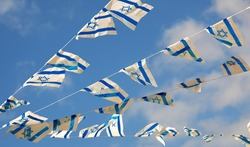 Israel flag in white and blue showing the Star of David hanging proudly for Israel's Independence Day (Yom Haatzmaut)