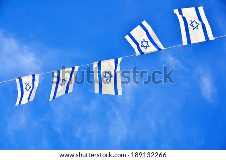 Israel flags in a chain in white and blue showing the Star of David hanging proudly for Israel\'s Independence Day (Yom Haatzmaut)