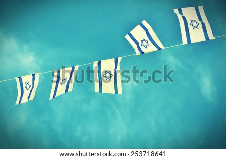 Israel flags in a chain in white and blue showing the Star of David hanging proudly for Israel's Independence Day (Yom Haatzmaut) - vintage retro effect