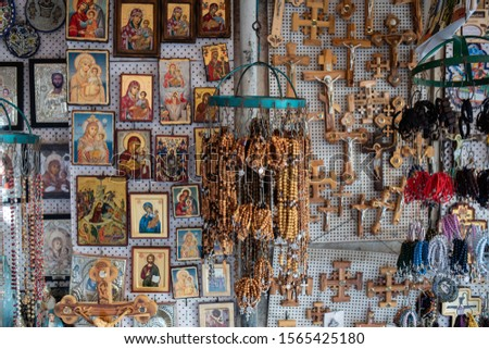 ISRAEL, JERUSALEM: wooden crosses, pictures of Jesus, Mary and other Saints, and religious articles, souvenir shop on the streets of the Old City of Jerusalem
