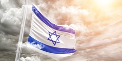 Israel national flag cloth fabric waving on beautiful grey sky.