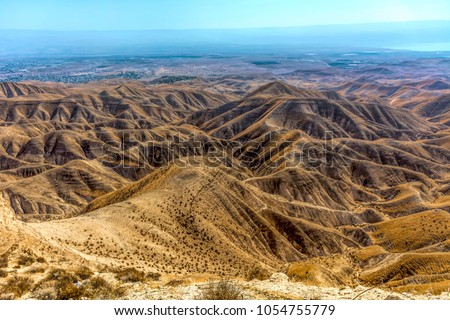 Israel, Negev, desert. overview on the Negef desert with its rough lined structure from a high point, in the distance you can see the Dead Sea at 12 kilometers distance. #1054755779