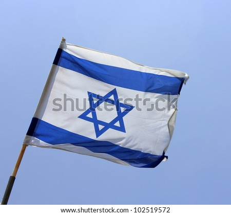 Israel's national flag on blue sky background