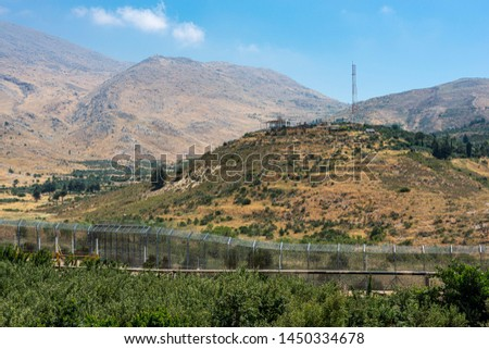Israel Syria border fence facing a UN observing station on the Syrian side