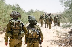 Israeli combat soldiers of an elite counter-terror unit return back to base after a raid in South of Lebanon during the Second Lebanon military campaign / war. Two soldiers in the foreground.
