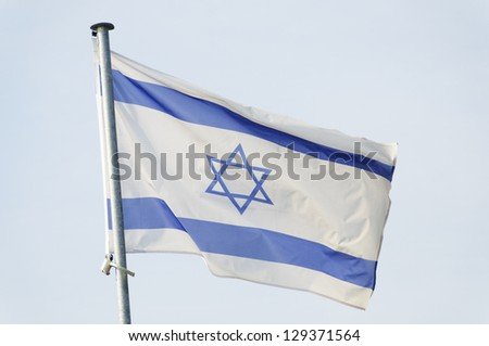 Israeli flag on a mast, sky background