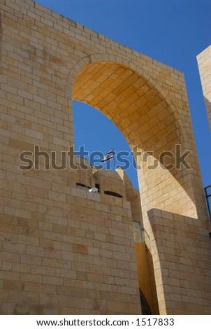 Israeli flag seen through a modern building near the Temple Mount Old City Jerusalem Israel