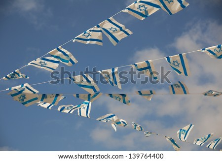 Israeli flags showing the Star of David hanging proudly for Israel\'s Independence Day (Yom Haatzmaut)