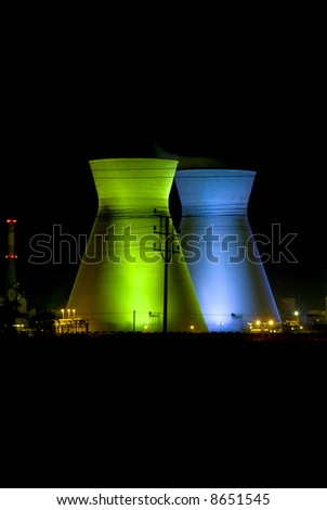 Israeli oil Refinery in Haifa by night illuminated in green and blue