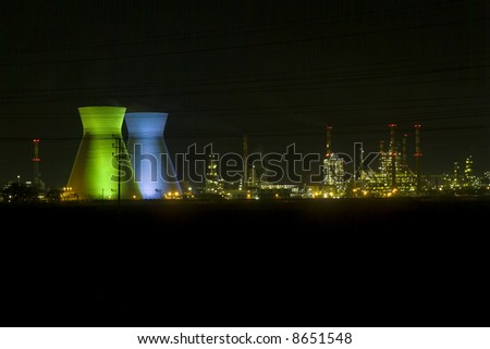 Israeli oil Refinery in Haifa by night illuminated in green and blue - stock photo