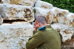 Israeli soldier crying and mourning for the fallen soldiers. Concept: Israeli soldiers, Israel Memorial Day - Yom HaZikaron