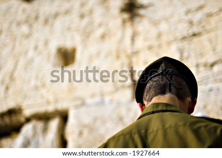 Israeli soldier praying at the wailing wall (western wall), Jerusalem, Israel