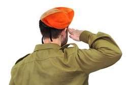 Israeli soldier with Israel flag salutes in an orange beret. White isolated background