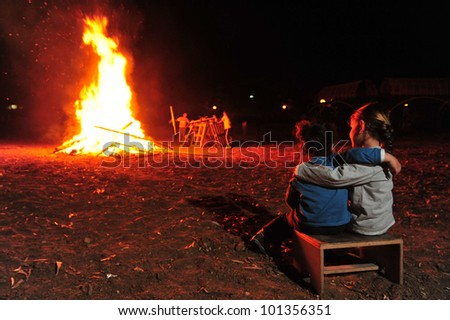 Israeli youth celebrate by a bonfire the Jewish holiday of Lag Baomer, a festive day on the Jewish calendar to commemorate the death of Rabbi Shimon Bar Yochai.