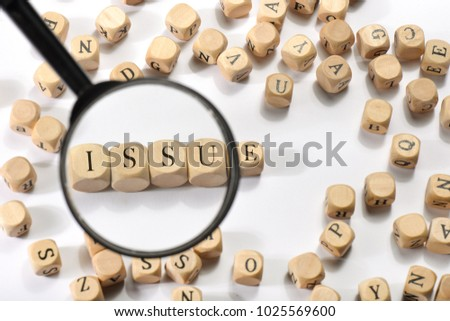 Issue word on wooden cubes. Issue concept
