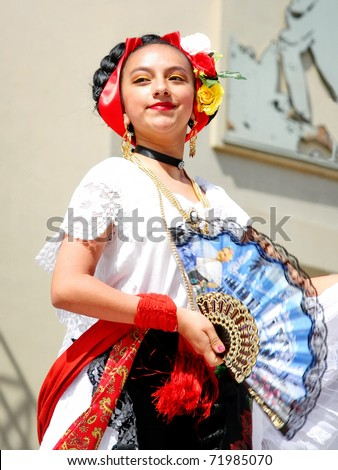 "ISTANBUL - APRIL 23: An unidentified 12 years old Mexican girl in traditional costume perform folk dance on ""National Sovereignty and Children Day"" festival, April 23, 2010 in Istanbul, Turkey"