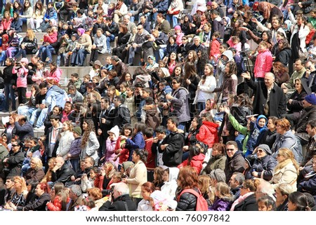 ISTANBUL - APRIL 23: Crowd of music fans cheer up during pop singer Bengu Erden performs live at Marmara Egitim Kurumlari on April 23, 2011 in Istanbul, Turkey.