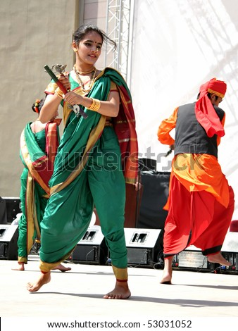 "ISTANBUL - APRIL 25: Indian girl in traditional costume perform at the ""National Sovereignty and Children Day"" festival at Maltepe University on April 25, 2010 in Istanbul, Turkey."