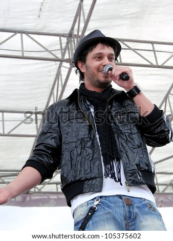 ISTANBUL - APRIL 23: Murat Boz performs live for the children during National Sovereignty and Children Day on April 23, 2008 in Istanbul. Children's Festival was first celebrated in Turkey on 1920. - stock photo