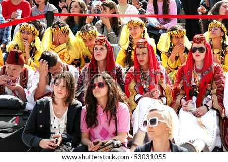 """ISTANBUL - APRIL 25: People in traditional costume during the """"National Sovereignty and Children Day"""" festival at Maltepe University on April 25, 2010 in Istanbul, Turkey. #53031055"""
