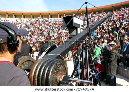"ISTANBUL - APRIL 23: Professional cameraman records live  at ""National Sovereignty and Children Day"" festival on April 23, 2010 in Istanbul, Turkey"