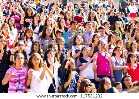 ISTANBUL - APRIL 22: Singer Atiye performs for the children during National Sovereignty and Children Day on April 22, 2012 in Istanbul. Children's Festival was first celebrated in Turkey on 1920.