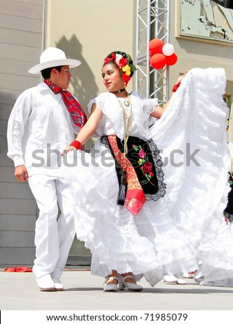 "ISTANBUL - APRIL 23: Unidentified 12 years old Mexican children in traditional costume perform folk dance on ""National Sovereignty and Children Day"" festival, April 23, 2010 in Istanbul, Turkey"