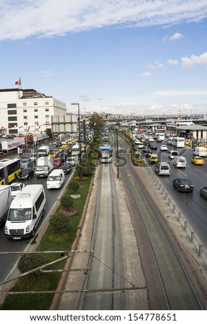 ISTANBUL, AUG 31, 2013: City Tram and heavy traffic jam circa Eminonu, Huge number of stopped cars in line during rush hour. on August 31, 2013 in Istanbul, Turkey.