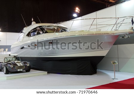 ISTANBUL - FEBRUARY 20: A yacht and a car during the 5th Sea Vehicles, Equipment and Accessories Exhibition on February 20, 2011 in Istanbul, Turkey.