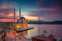 Istanbul. Image of Ortakoy Mosque with Bosphorus Bridge in Istanbul during beautiful sunrise.