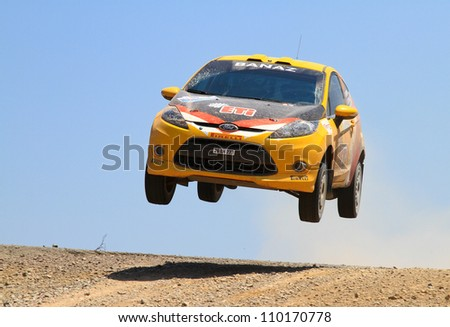 ISTANBUL - JULY 07: Bugra Banaz drives a Ford Fiesta R2 car during 41st Bosphorus Rally ERC Championship, Halli Stage on July 7, 2012 in Istanbul, Turkey.
