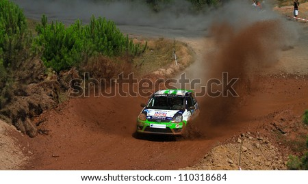 ISTANBUL - JULY 07: Burcu Burkut Erenkul drives a Bonus Parkur Racing team Ford Fiesta St car during 41st Bosphorus Rally ERC Championship, Gocbeyli Stage on July 7, 2012 in Istanbul, Turkey.
