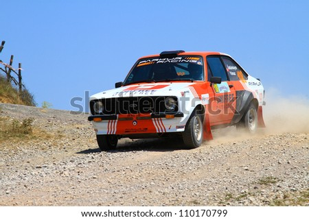 ISTANBUL - JULY 07: Demir Berberoglu drives a Ford Escort Mk2 car during 41st Bosphorus Rally ERC Championship, Halli Stage on July 7, 2012 in Istanbul, Turkey.